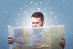 Young man holding map Stock Images