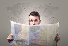 Young man holding map Royalty Free Stock Image