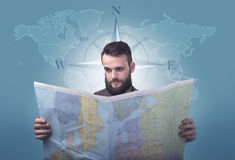 Young man holding map Royalty Free Stock Photos