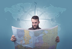 Young man holding map Royalty Free Stock Images