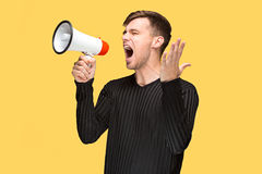 The young man holding a megaphone Stock Photos