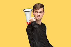 The young man holding a megaphone Royalty Free Stock Photo