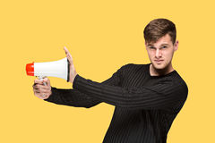 The young man holding a megaphone Royalty Free Stock Photography