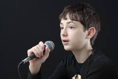 Young man holding microphone Stock Photography