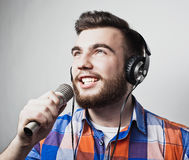 Young man holding a microphone Royalty Free Stock Photos