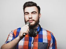 Young man holding a microphone Royalty Free Stock Photography