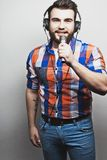 Young man  holding a microphone Royalty Free Stock Images