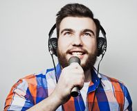 Young man  holding a microphone Stock Photo