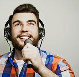 Young man holding a microphone Stock Image