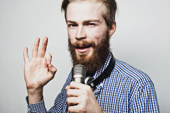 Young man holding a microphone Stock Images
