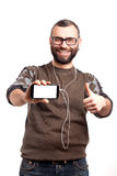 Young man holding a mobile phone Royalty Free Stock Images