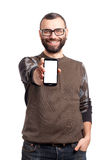 Young man holding a mobile phone Royalty Free Stock Photos