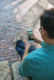 Young man holding mobile phone Royalty Free Stock Images