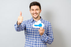 Young man holding model of cloud with blue key. Cloud computing, technology, connectivity concept Stock Photo