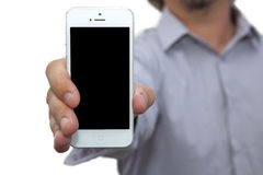 Young man holding modern phone Stock Photo