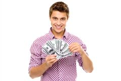 Young man holding money. Young man standing over white background Royalty Free Stock Images