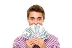 Young man holding money. Young man standing over white background Royalty Free Stock Photos