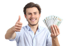 Young man holding money with thumbs up Stock Photos