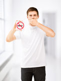 Young man holding no smoking sign Stock Images