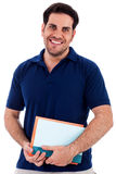 Young man holding notepad Stock Image