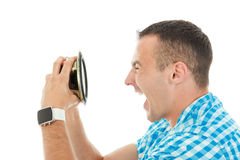 Young man holding object loudspeaker listening to loud music yel Royalty Free Stock Image