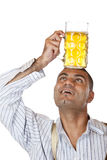 Young man holding Oktoberfest beer stein Royalty Free Stock Photography