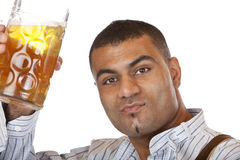 Young man holding Oktoberfest beer stein in hand Stock Photo