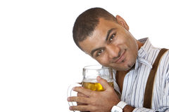 Young man holding Oktoberfest beer stein in hands Royalty Free Stock Image
