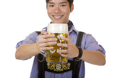 Young man holding Oktoberfest beer stein (Mass) Stock Image