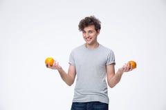 Young man holding orange Royalty Free Stock Image