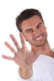 Young man holding out hand Stock Image