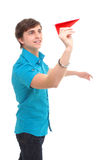 A young man holding a paper airplane Stock Photos