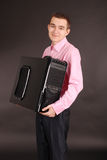 Young man holding a pc black Stock Photography