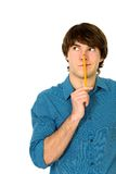 Young man holding pencil royalty free stock photos