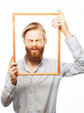 Young man holding picture frame Stock Image