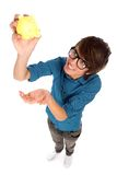 Young man holding piggy bank Royalty Free Stock Photography