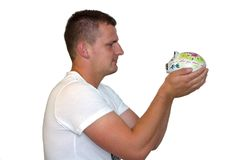 Young Man Holding Piggy Bank Stock Image