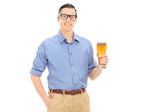 Young man holding a pint of beer. Isolated on white background stock photos