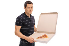 Young man holding a pizza box Royalty Free Stock Photos