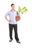Young man holding a plant Stock Photo