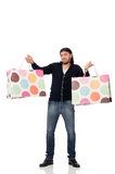 The young man holding plastic bags isolated on white Royalty Free Stock Photo