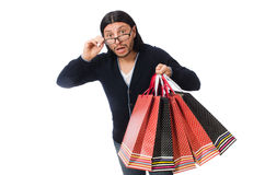 The young man holding plastic bags isolated on white Stock Image
