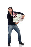 The young man holding plastic bags isolated on white Stock Photo