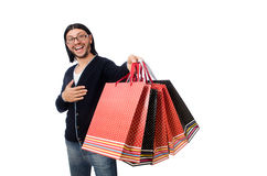 Young man holding plastic bags isolated on white Stock Images