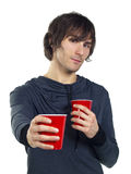 Young man holding plastic drinking cups Royalty Free Stock Photo