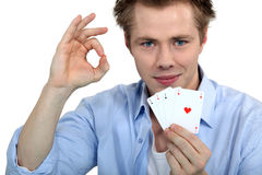Young man holding playing cards Stock Photography