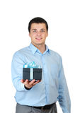 Young man holding present box Royalty Free Stock Photography