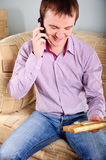 Young man holding a present box Stock Photography
