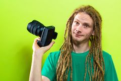 Young man holding a professional camera Royalty Free Stock Images