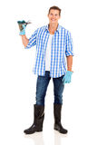 Young man holding pruner royalty free stock photography
